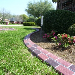 Terracotta-Brick-Look-Concrete-Edging-Designed-To-Match-House