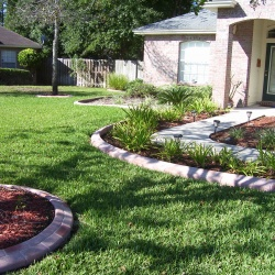 Terracotta-Brick-Look-Concrete-Edging-With-Variations-In-Color-To-Match-Home